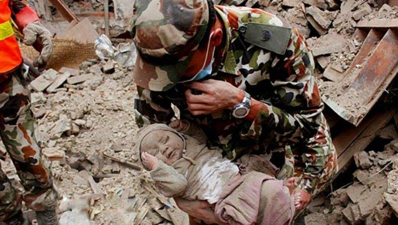 Nepal-Earthquake-Miracle-A-4-month-old-baby-pulled-out-alive-from-rubble-22-hrs-after-earthquake
